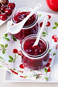 Two jars of red cherry jelly