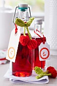 Cherry liqueur in little bottles decorated with crocheted cherries and stamped labels