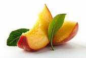 Two peach wedges