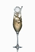 Champagne splashing out of a glass