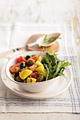 Mediterranean potato salad with rocket, tomatoes and olives