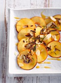 Nectarine carpaccio with sliced almonds and chocolate shavings