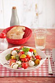 Tomato salad with mozzarella and pesto