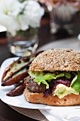 A hamburger with onion confit and lettuce