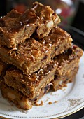 Caramel brownies with macadamia nuts and cranberries