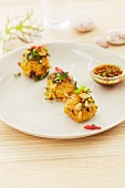 Rice balls with garlic, shallots, mint, egg and bacon (Asia)