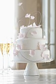 Three-tier wedding cake with paper butterflies