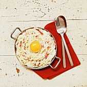 Spaghetti carbonara with egg