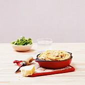 Spaghetti bake with goose liver and parmesan