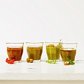 Assorted pesto sauces in glasses