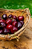 Cherries in a basket on a table outdoors