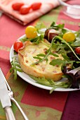 Quiche Lorraine with cherry tomatoes and rocket