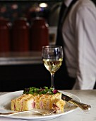 Croque Monsieur with a glass of white wine