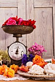 Assorted roses with a set of old kitchen scales