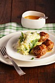 Meatballs with mashed potato and rocket