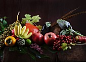 A still life featuring autumn fruits and vegetables (in the style of an Old Master)
