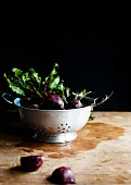 Bunch of beetroot in a metal colander