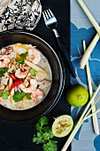 thai curry noodle soup with prawns and fresh lime
