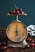 Antique weighing scales with cherries