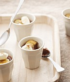 Chocolate panna cotta with caramelised bananas and cinnamon cream