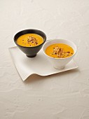 Cream of pumpkin soup with chopped nuts
