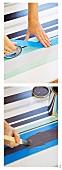 Herstellung von Streifenmuster auf weißem Untergrund durch Abkleben mit Klebeband und Streichen mit dem Pinsel von Frauenhänden ausgeführt
