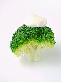 Cooked broccoli with a blob of mayonnaise