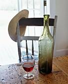 Glass of Wine with a Bottle on a Table