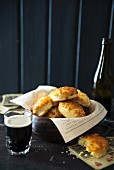 Cheese-topped bread rolls and beer