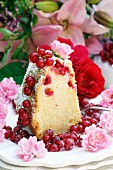 Bundt cake with redcurrants and rose decorations