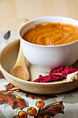 Carrot purée with tamari and peanuts and a beetroot dip