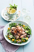 Octopus salad with rocket, mango, cucumbers and red onions