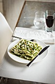 Open lasagne with pesto, ricotta and pine nuts