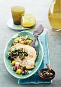 Baked plaice fillets with olive gremolata and a potato & courgette medley
