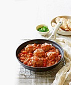 Meatballs in tomato and bean sauce