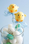 Easter chick cake pops and chocolate eggs in a glass