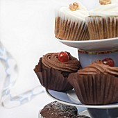Assorted cupcakes and muffins on a cake stand (section)