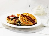 Waffles with blueberries and maple syrup