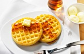 Waffles with butter and maple syrup for breakfast