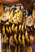 Spanish hams hanging up at the market (Palma, Majorca)