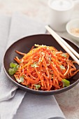 Fried grated carrots with sesame seeds and coriander (Asia)