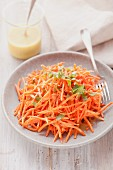 Grated carrot salad with dressing