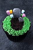 A gruesomely decorated cupcake for Halloween