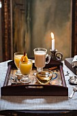 Three assorted winter hot drinks on a tray