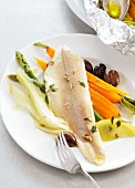 Trout fillet baked in foil with vegetable accompaniments