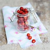 Wild strawberries in a preserving jar