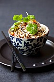 Three kinds of rice with raisins and coriander in a bowl