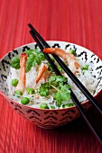 Vermicelli with prawns, peas, sesame seeds and coriander