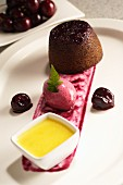 Steamed cherry pudding with cherry ice cream and custard