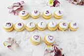 Cupcakes spelling out words at a wedding